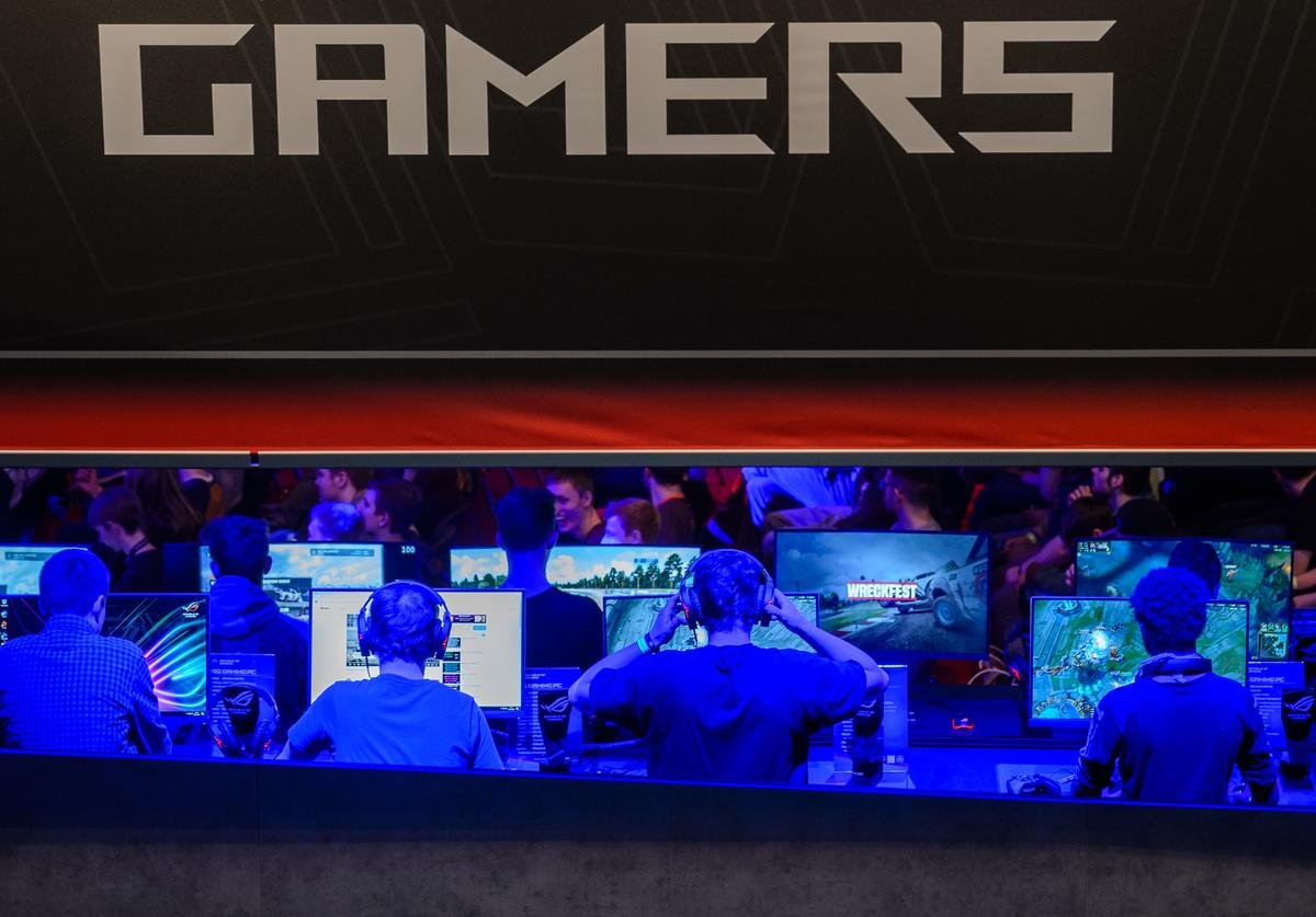 Participants sit at computer monitors to play video games at the 2018 DreamHack video gaming festival on January 27, 2018 in Leipzig, Germany. The three-day event brings together gaming enthusiasts mainly from German-speaking countries for events including eSports tournaments, cosplay contests and a LAN party with 1,500 participants.