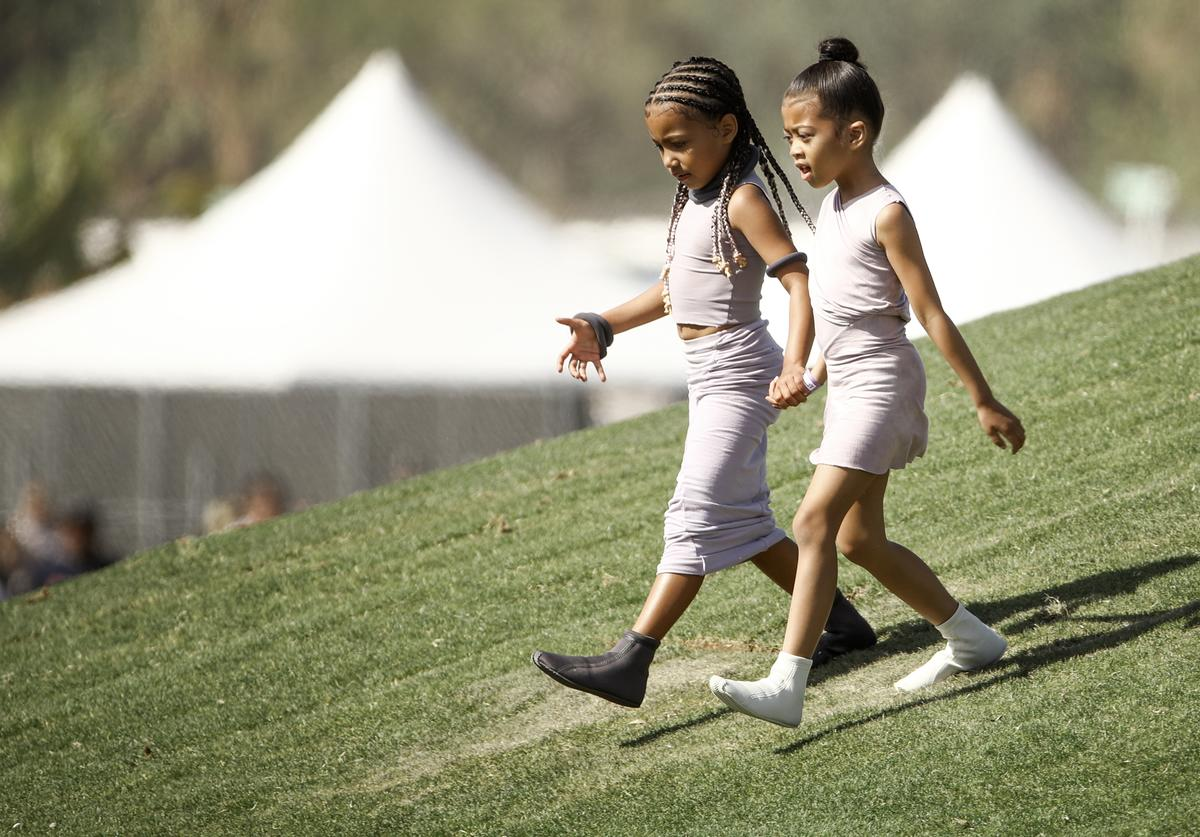 North West (L) and Ryan Romulus attend Sunday Service during the 2019 Coachella Valley Music And Arts Festival on April 21, 2019 in Indio, California