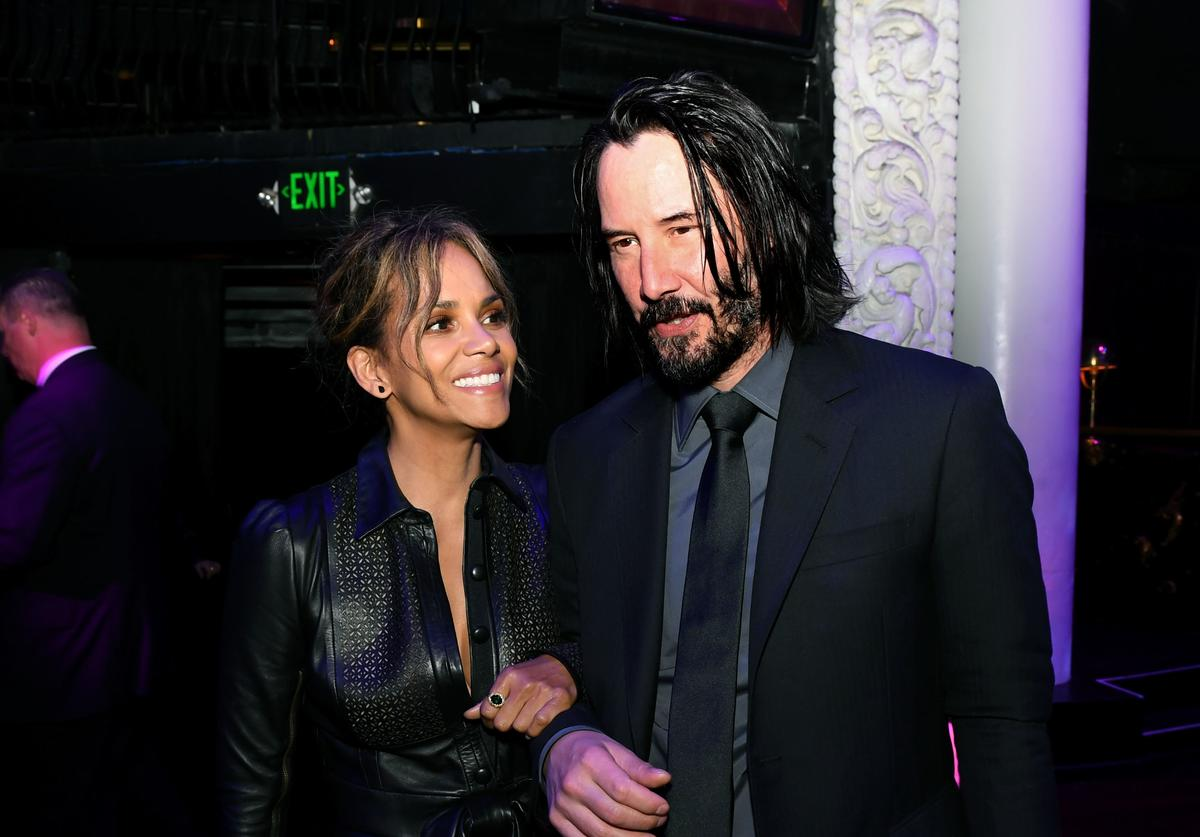 "Halle Berry (L) and Keanu Reeves pose at the after party for a special screening of LionsGate's ""John Wick: Chapter 3 - Parabellum"""