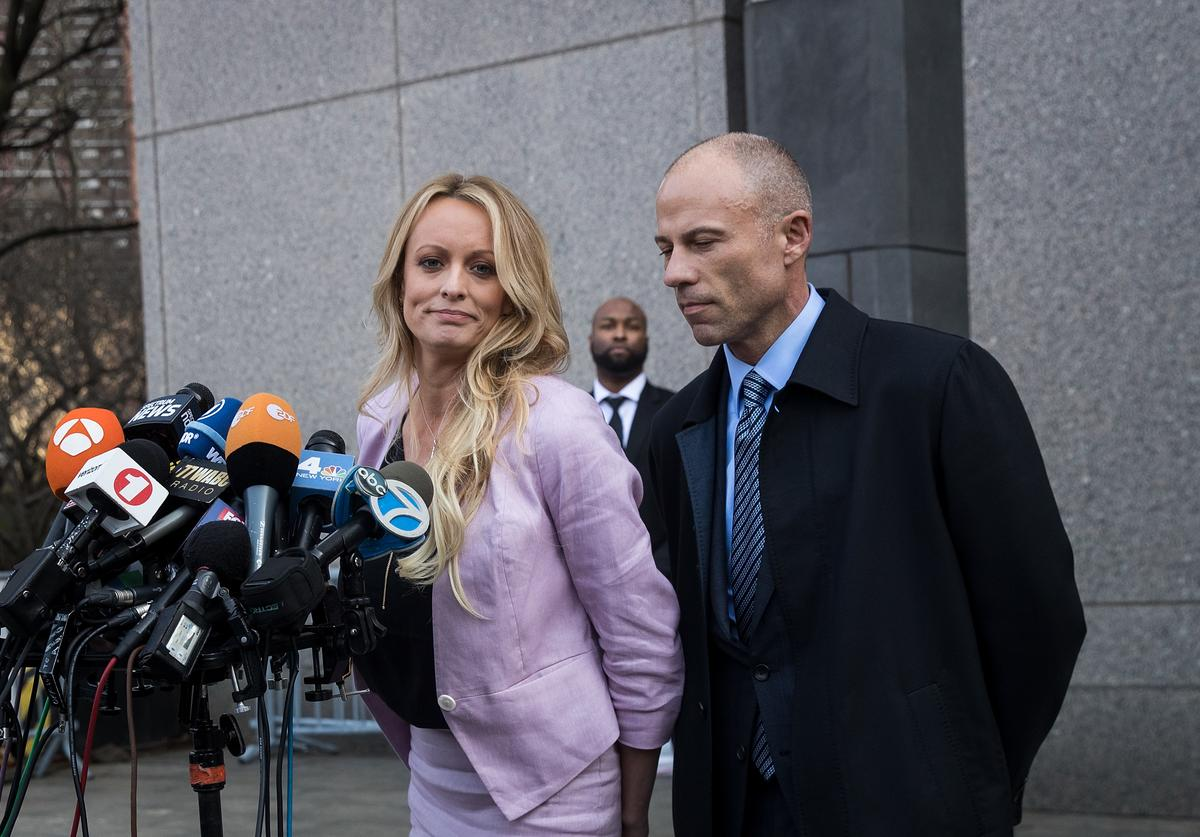 Adult film actress Stormy Daniels (Stephanie Clifford) and Michael Avenatti, attorney for Stormy Daniels, speak to the media as they exit the United States District Court Southern District of New York for a hearing related to Michael Cohen, President Trump's longtime personal attorney and confidante, April 16, 2018 in New York City. Cohen and lawyers representing President Trump are asking the court to block Justice Department officials from reading documents and materials related to Cohen's relationship with President Trump that they believe should be protected by attorney-client privilege. Officials with the FBI, armed with a search warrant, raided Cohen's office and two private residences last week.