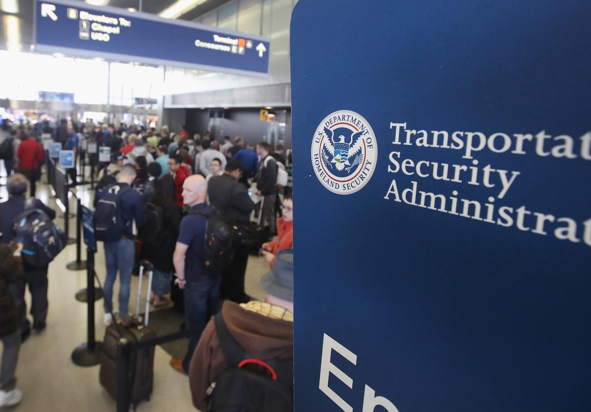 Passengers at O'Hare International Airport wait in line to be screened at a Transportation Security Administration (TSA) checkpoint on May 16, 2016 in Chicago, Illinois