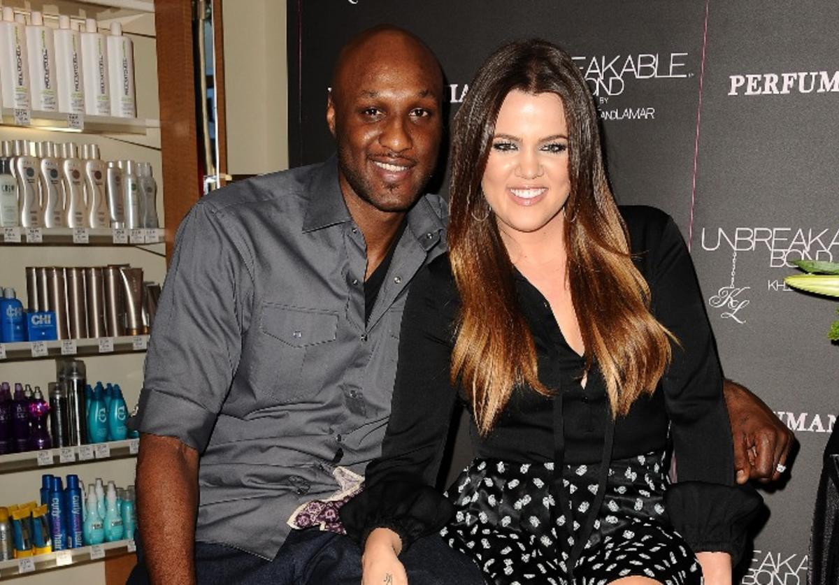 """Lamar Odom and Khloe Kardashian make a personal appearance for """"Unbreakable Bond"""" at Perfumania on June 7, 2012 in Orange, California."""