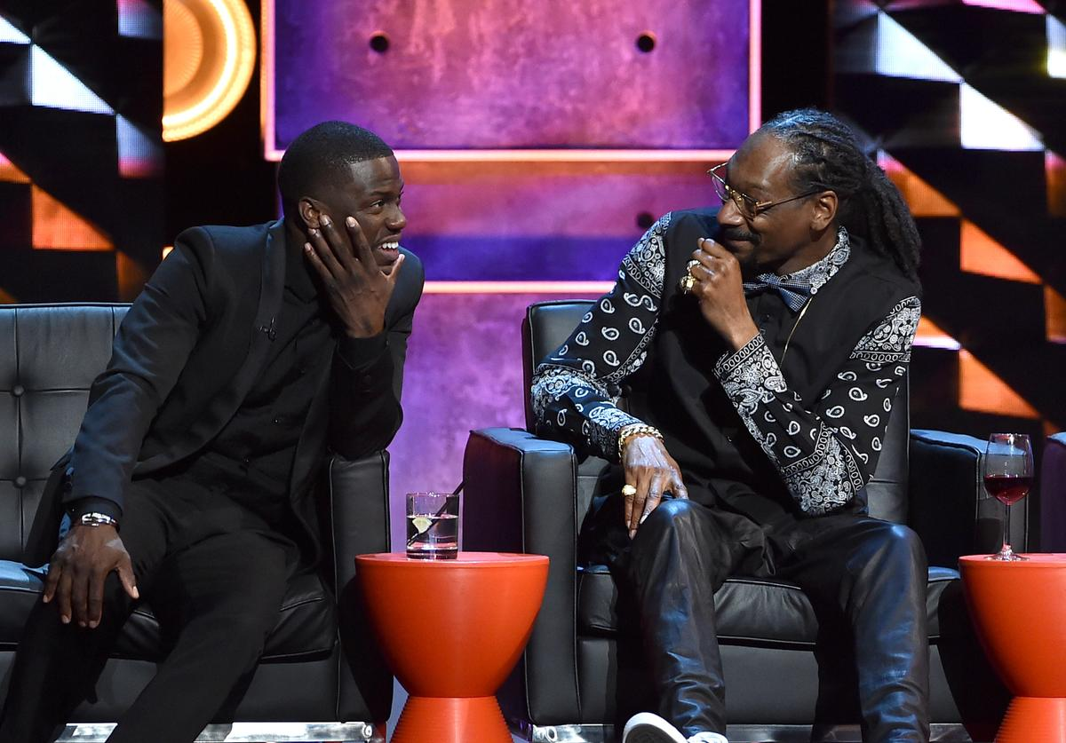 Roastmaster Kevin Hart (L) and rapper Snoop Dogg onstage at The Comedy Central Roast of Justin Bieber at Sony Pictures Studios on March 14, 2015 in Los Angeles, California. The Comedy Central Roast of Justin Bieber will air on March 30, 2015 at 10:00 p.m. ET/PT.