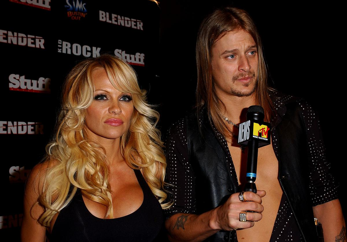 Musician Kid Rock and actress Pamela Anderson arrive at the Kid Rock After-Party for the American Music Awards at Forbidden City on November 16, 2003 in Hollywood, California. The party was hosted by Stuff Magazine and Blender.