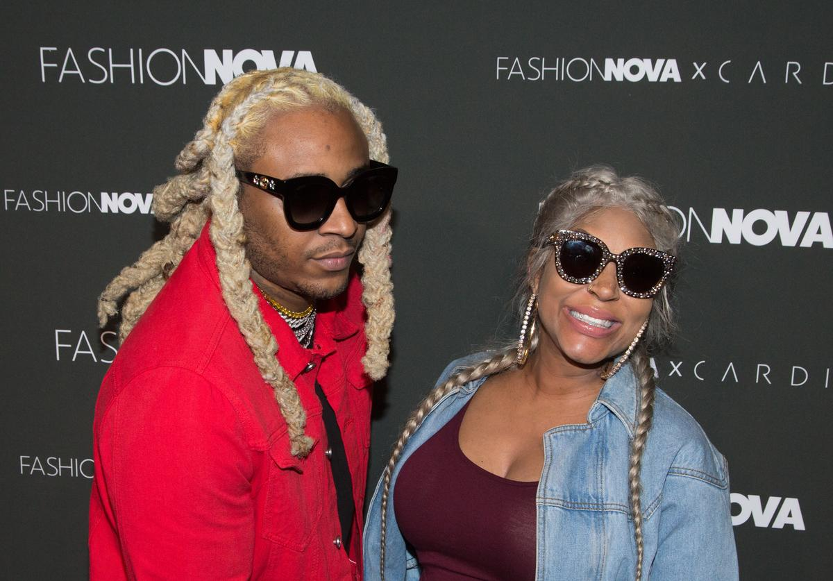 Floyd 'A1' Bentley (L) and Lyrica Anderson arrive for Fashion Nova x Cardi B Collaboration Launch Event at Boulevard3 on November 14, 2018 in Hollywood, California
