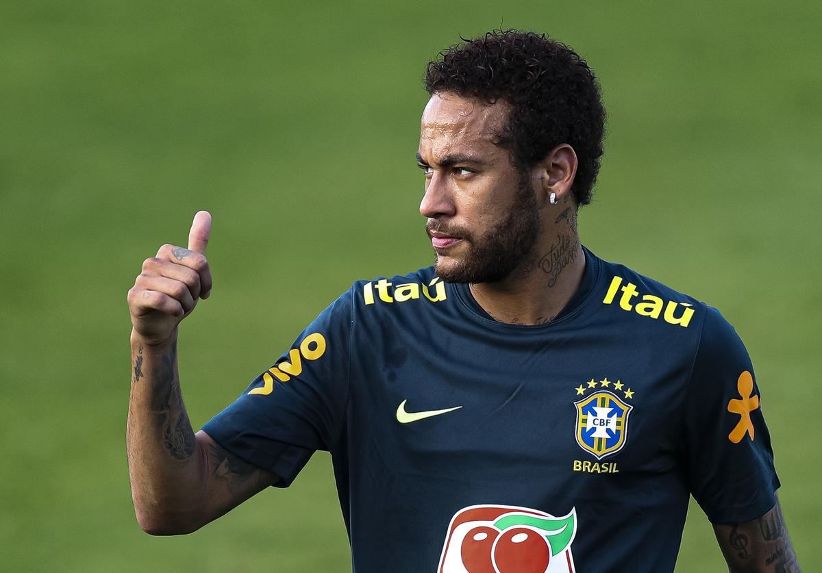 Neymar Jr gestures during a training session of the Brazilian national football team