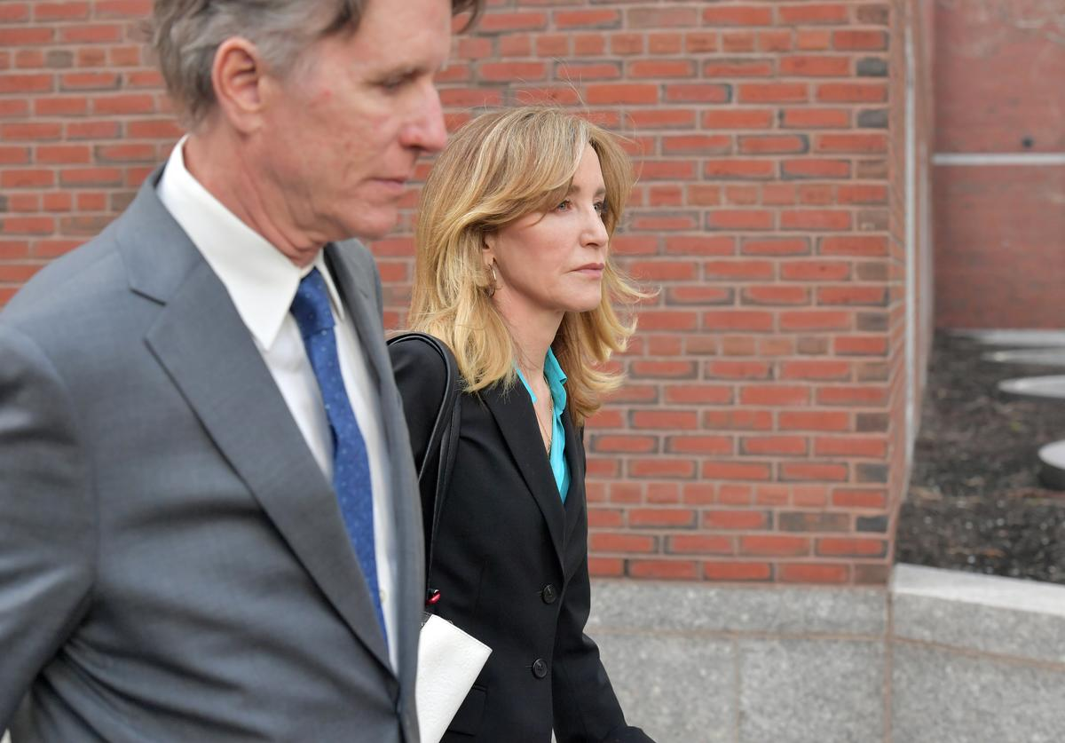 Felicity Huffman exits the John Joseph Moakley U.S. Courthouse after appearing in Federal Court
