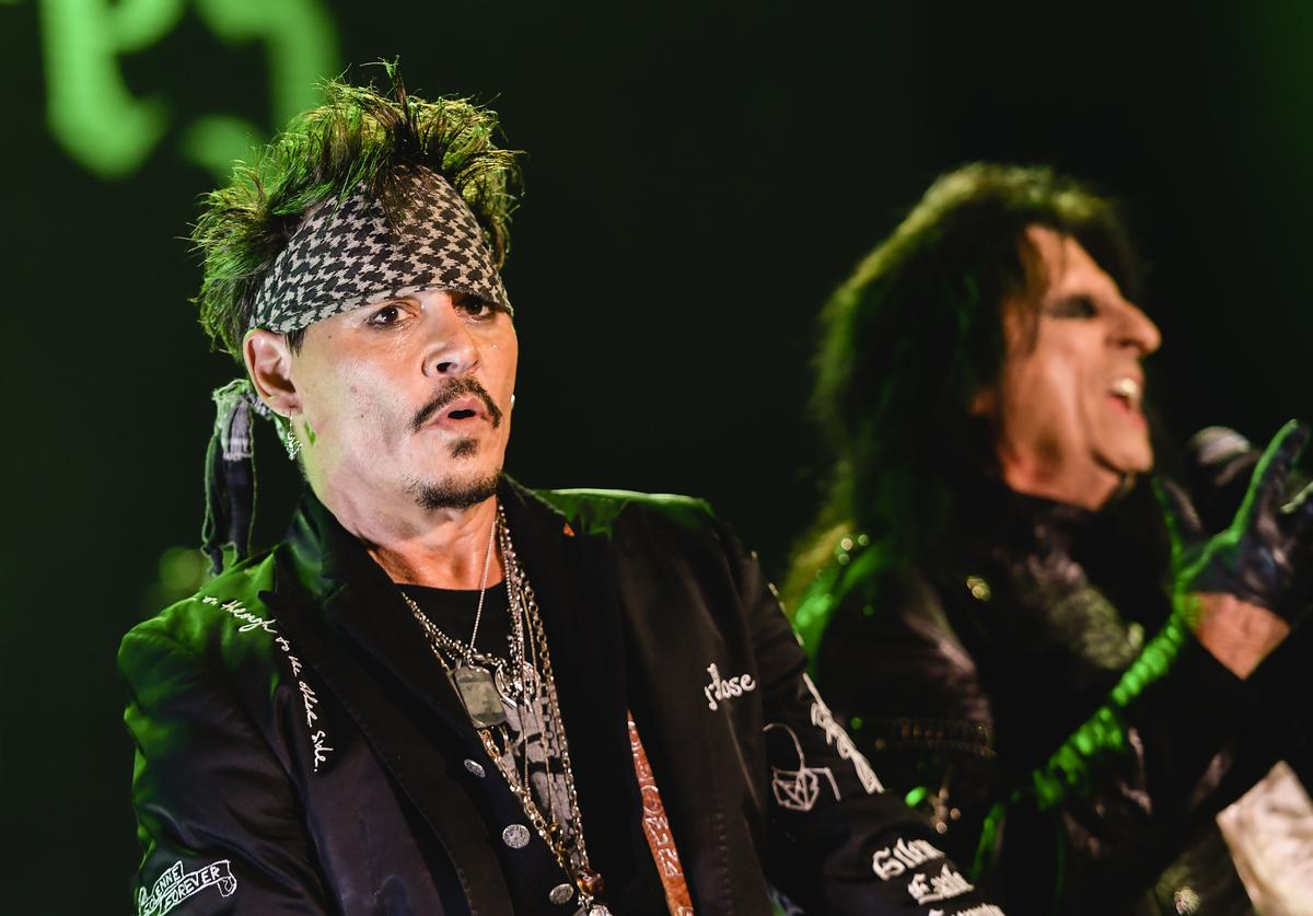 Johnny Depp performing w his band