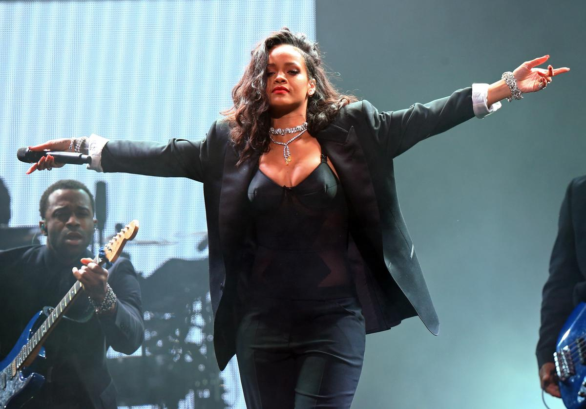 Singer Rihanna performs onstage during DirecTV Super Saturday Night hosted by Mark Cuban's AXS TV and Pro Football Hall of Famer