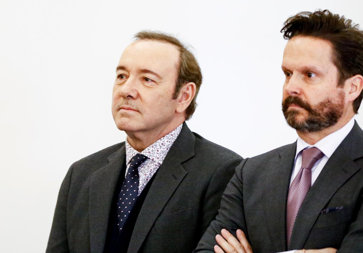 Actor Kevin Spacey (L) attends his arraignment on sexual assault charges with his lawyer Alan Jackson