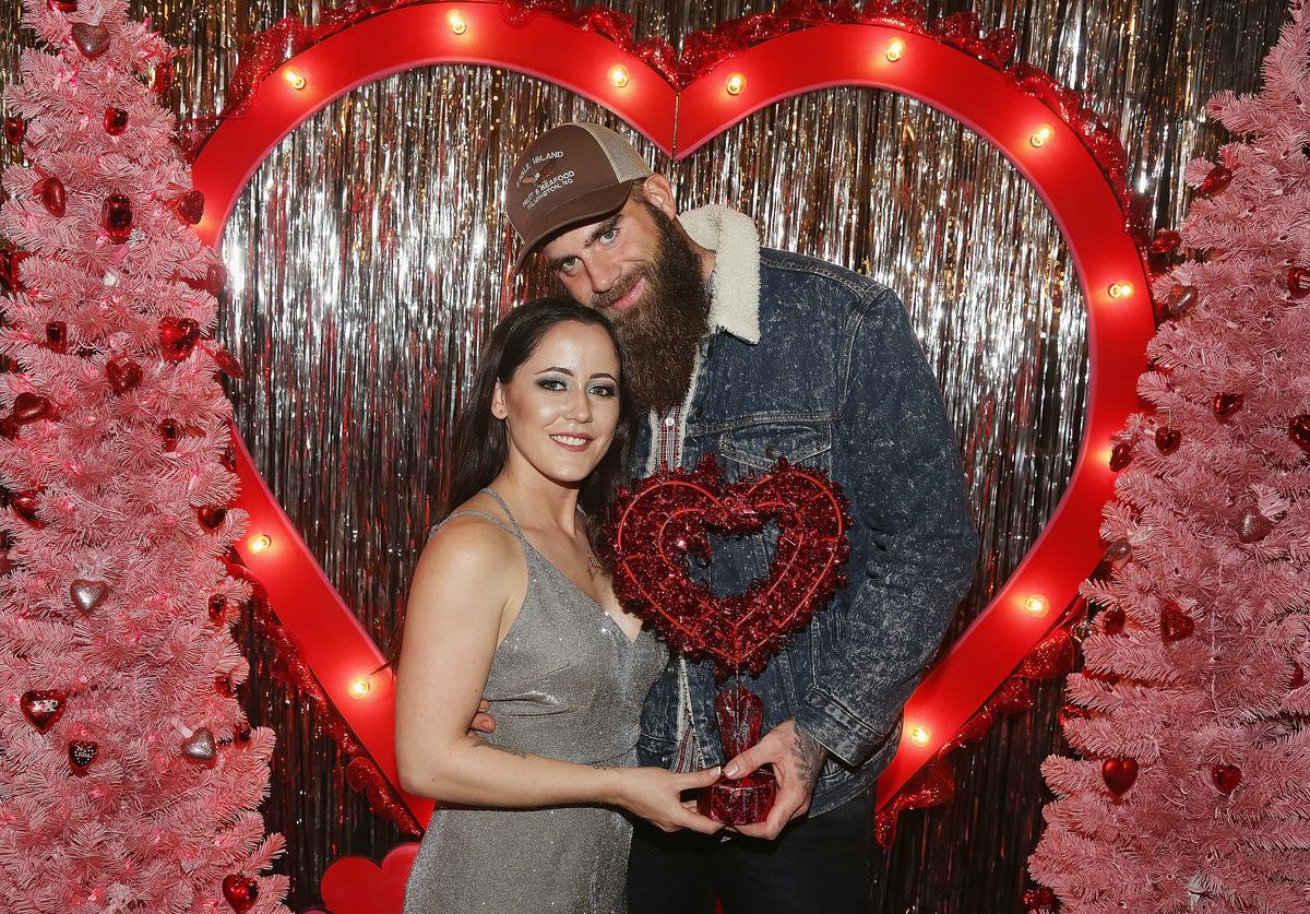 Janelle Evans and David Eason pose at The Planet Hollywood Valentine's Wonderland at the Cosmopolitan New York Fashon Week #Eye Candy event After Party at Planet Hollywood Times Square on February 8, 2019 in New York City