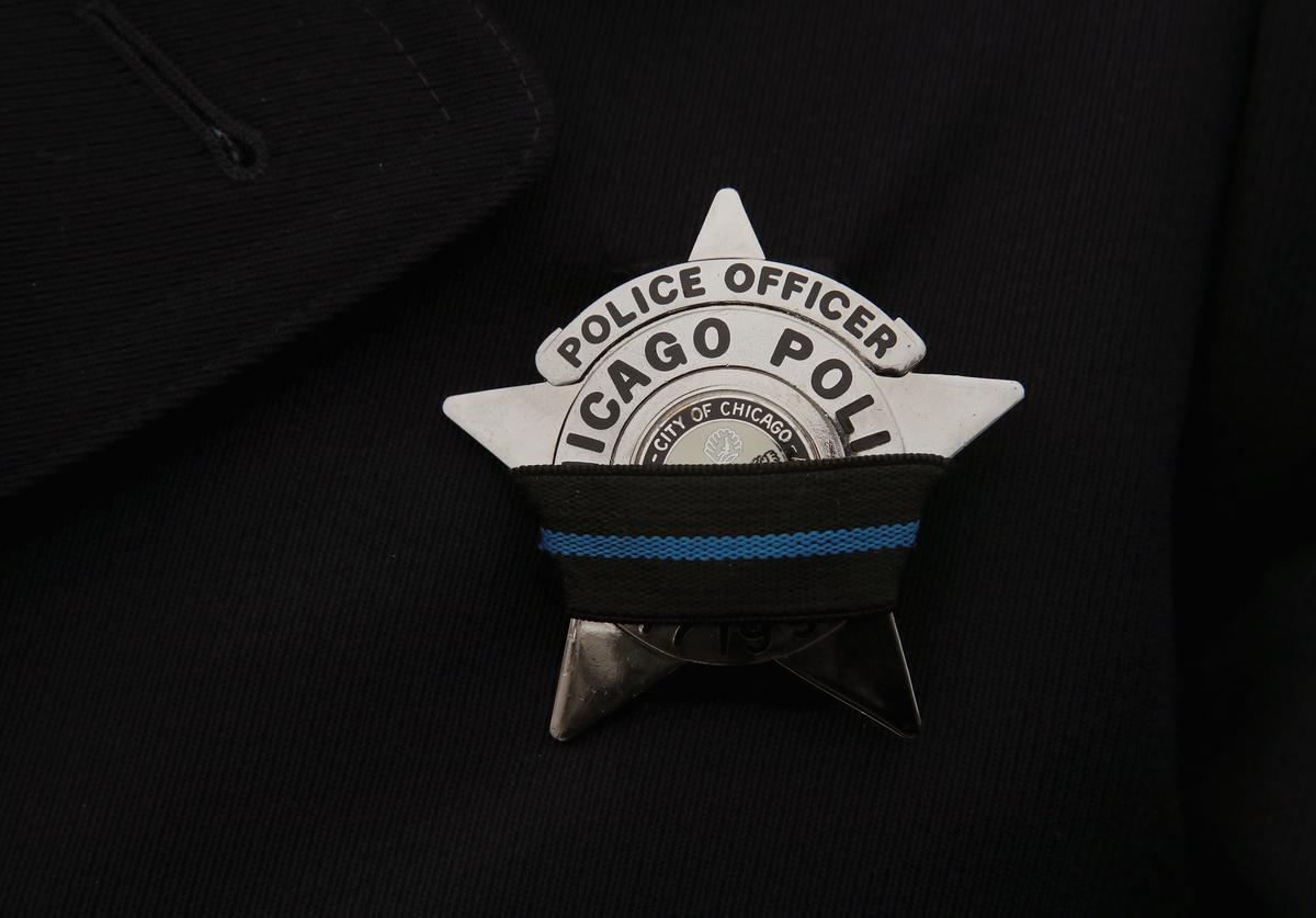 A police officer wears a mourning band on his badge as his department mourns Chicago Police Officer Samuel Jimenez