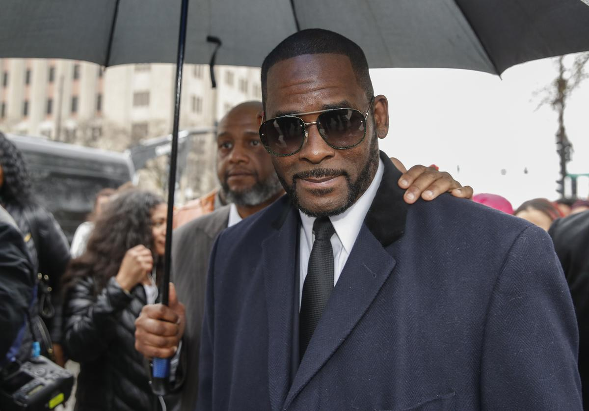R. Kelly leaves the Leighton Criminal Court Building after a hearing on sexual abuse charges