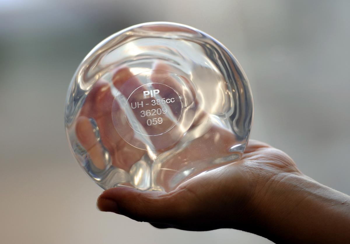 A picture taken on January 3, 2012 in Marseille, southeastern France, shows a breast implant produced by the implant manufacturer Poly Implant Prothese company (PIP) with PIP identity card