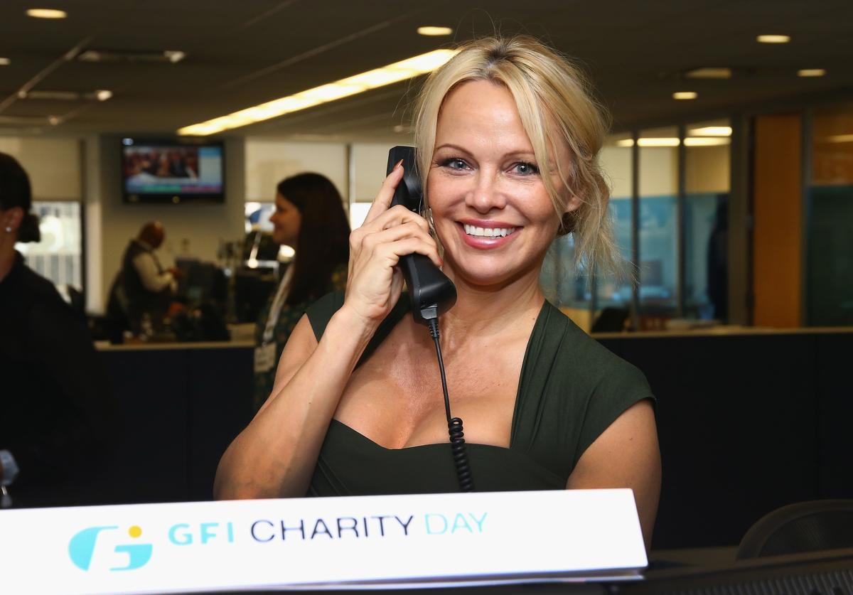 Pamela Anderson participates in the Annual Charity Day hosted by Cantor Fitzgerald, BGC and GFI at GFI Securities on September 11, 2017 in New York City.