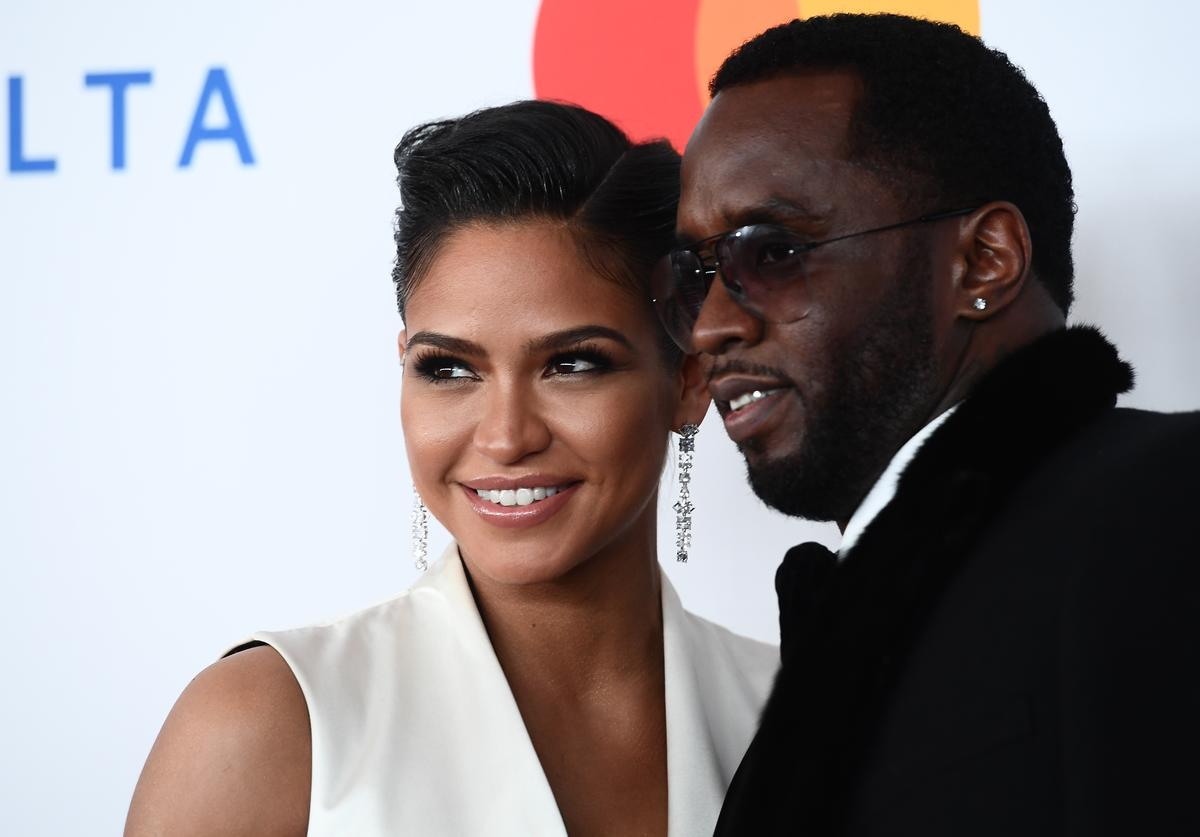 Cassie Ventura (L) and Rap mogul P Diddy (aka Sean Combs) arrive for the traditionnal Clive Davis party on the eve of the 60th Annual Grammy Awards on January 28, 2018, in New York