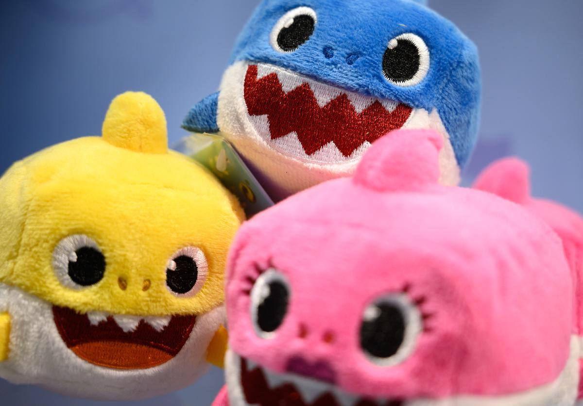 "A selection of ""Baby Shark"" toys are seen on a display at the annual ""Toy Fair"" at Olympia London on January 22, 2019 in London, England."
