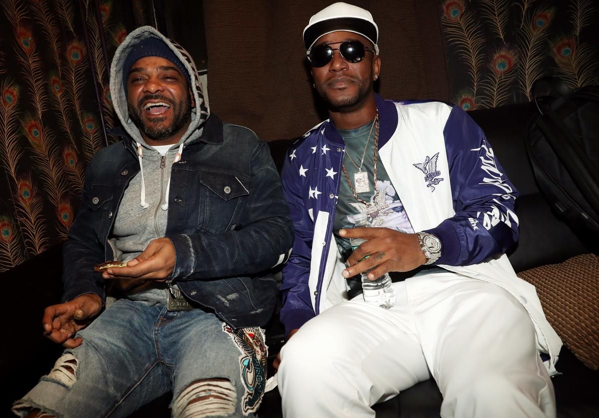 Jim Jones (L) and Cam'ron backstage at Irving Plaza on December 22, 2017 in New York City.