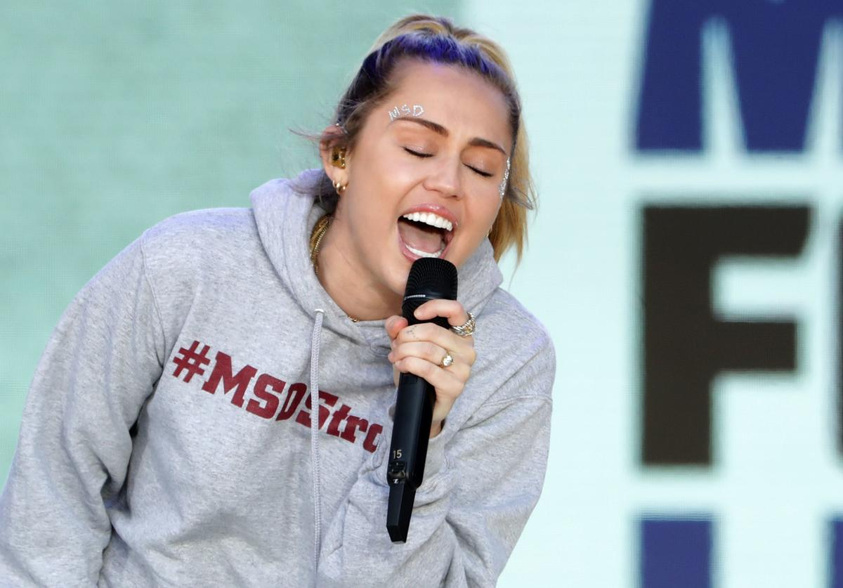 """Miley Cyrus performs """"The Climb"""" during the March for Our Lives rally on March 24, 2018 in Washington, DC. Hundreds of thousands of demonstrators, including students, teachers and parents gathered in Washington for the anti-gun violence rally organized by survivors of the Marjory Stoneman Douglas High School shooting on February 14 that left 17 dead. More than 800 related events are taking place around the world to call for legislative action to address school safety and gun violence."""