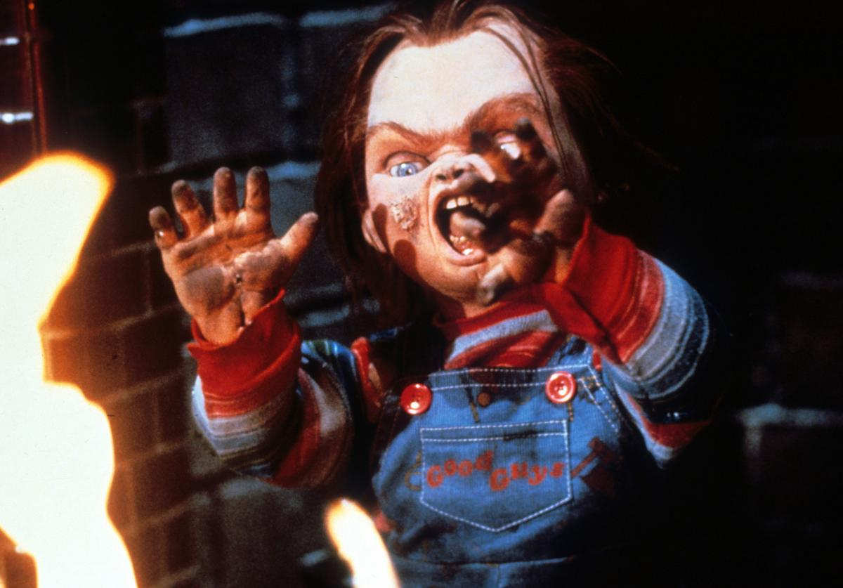 Chucky near flames in a scene from the film 'Child's Play', 1988