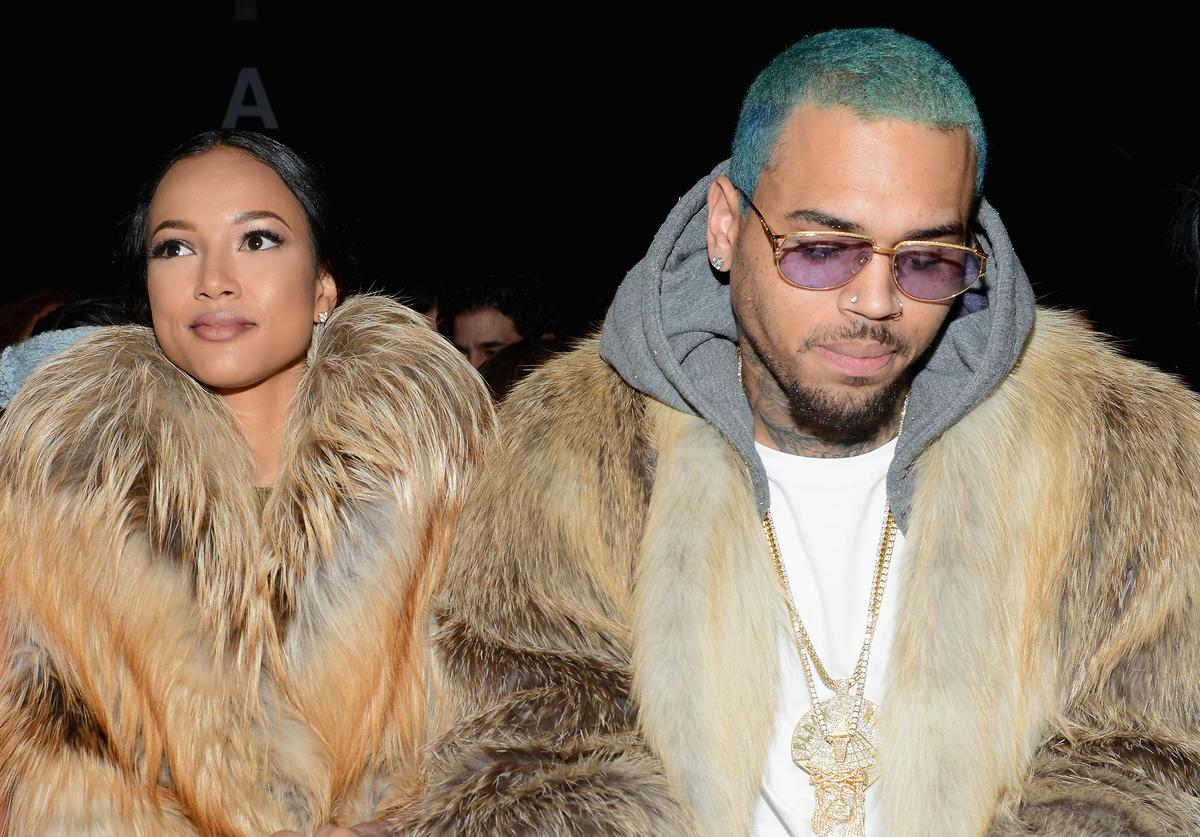 Karrueche Tran (L) and Chris Brown attend the Michael Costello fashion show during Mercedes-Benz Fashion Week Fall 2015 at The Salon at Lincoln Center on February 17, 2015 in New York City