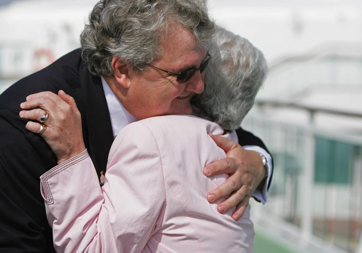 Nicci Pugh who was a Senior Nursing Officer embraces veteran John Jones, a double amputee during a reunion of injured servicemen of the 1982 Falklands war and members of the RN Medical and Queen Alexandra's Royal Naval Nursing Service teams on board the P&O Cruises superliner Aurora on April 20 2008 in Southampton, England.