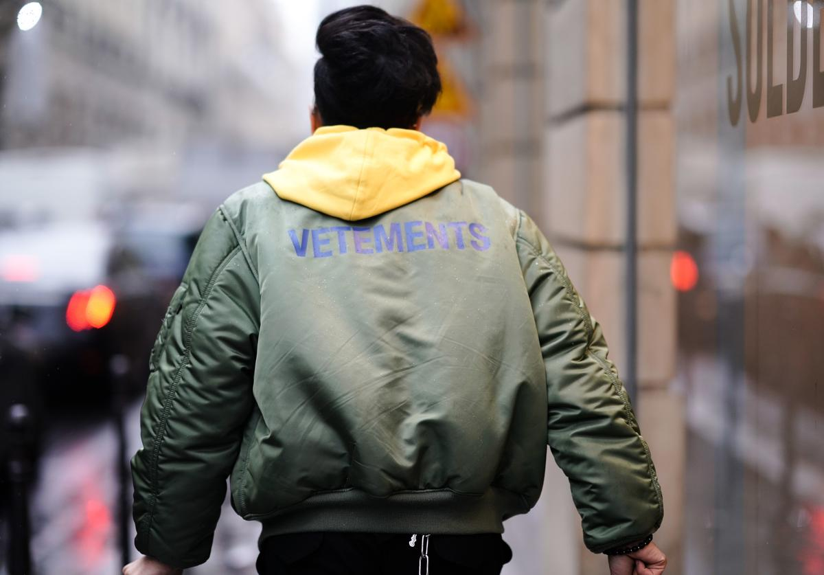 A guest wears a Vetements green bomber jacket, during Paris Fashion Week - Haute Couture Spring Summer 2020, on January 23, 2019 in Paris, France.