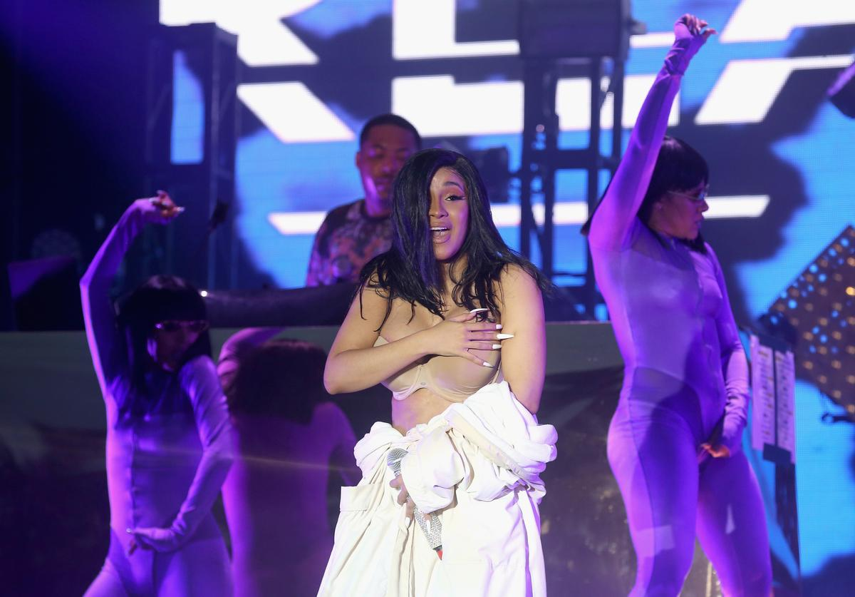 Cardi B performs in a Palms Casino robe on day four of Bonnaroo Music And Arts Festival on June 16, 2019 in Manchester, Tennessee