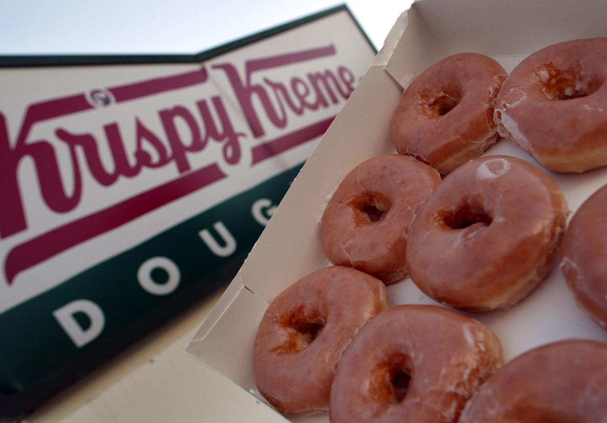 Glazed Krispy Kreme doughnuts are seen May 17, 2004 in Miami, Florida. Krispy Kreme Doughnuts Inc. last week said that the low-carb diet trend has hurt sales and they now face shareholder lawsuits alleging it misled investors about the direction its business was headed.