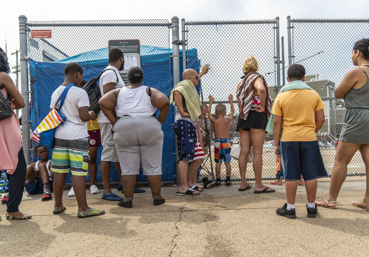 People wait in line at a public pool that is filled to capacity during a heatwave on July 1, 2018 in Philadelphia, Pennsylvania