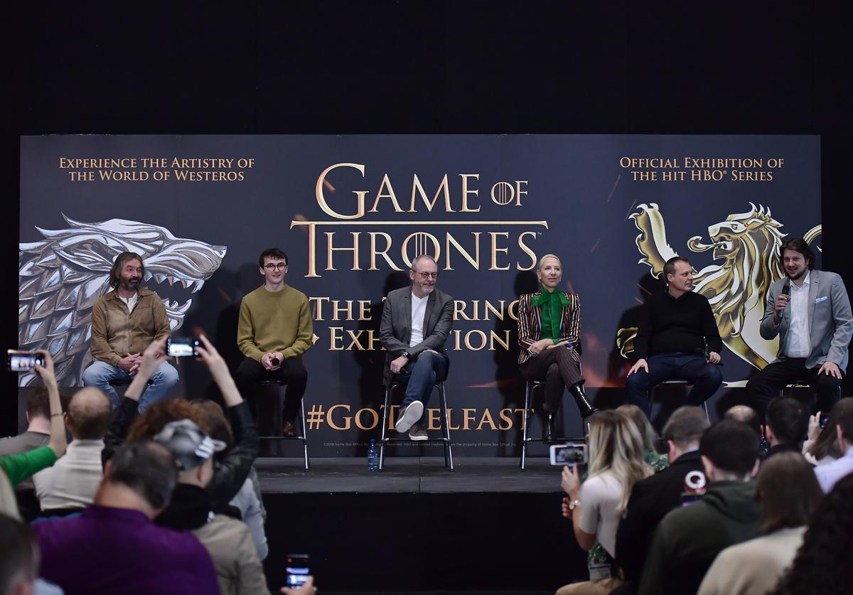 Game of Thrones cast members Ian Beattie (L), Isaac Hempstead Wright (2nd L) and Liam Cunningham (C) alongside costume designer Michele Clapton (3rd R), Jeff Peters of HBO (2nd R) and Robin Stapley (R) attend the Game Of Thrones: The Touring Exhibition press conference at Titanic Exhibition Centre