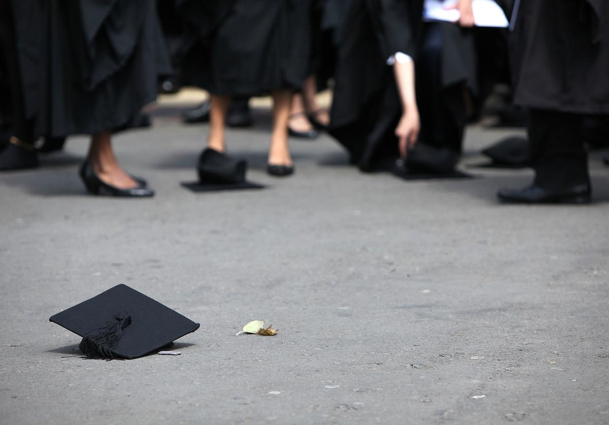 Students pick up their mortarboards after the offical hat throwing photograph at the University of Birmingham on July 14, 2009 in Birmingham, England.