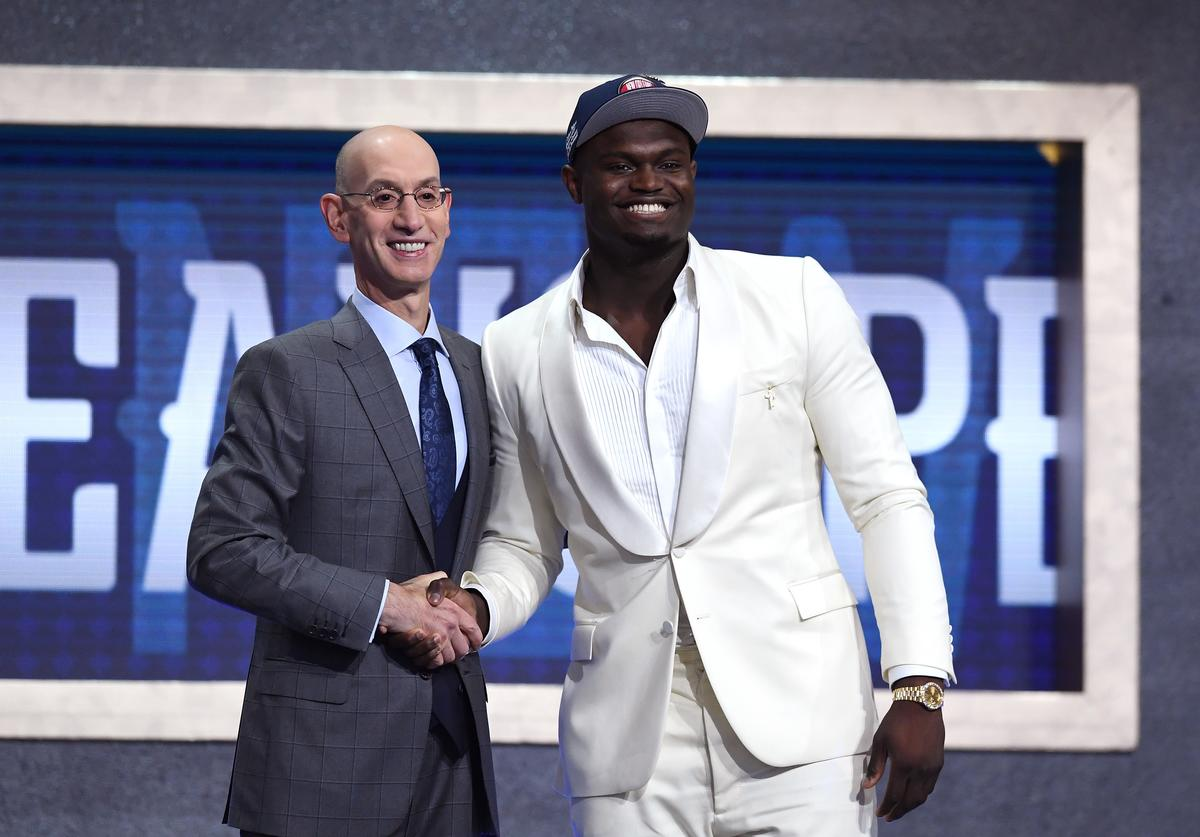 Zion Williamson poses with NBA Commissioner Adam Silver after being drafted with the first overall pick by the New Orleans Pelicans during the 2019 NBA Draft at the Barclays Center on June 20, 2019 in the Brooklyn borough of New York City. NOTE TO USER: User expressly acknowledges and agrees that, by downloading and or using this photograph, User is consenting to the terms and conditions of the Getty Images License Agreement.