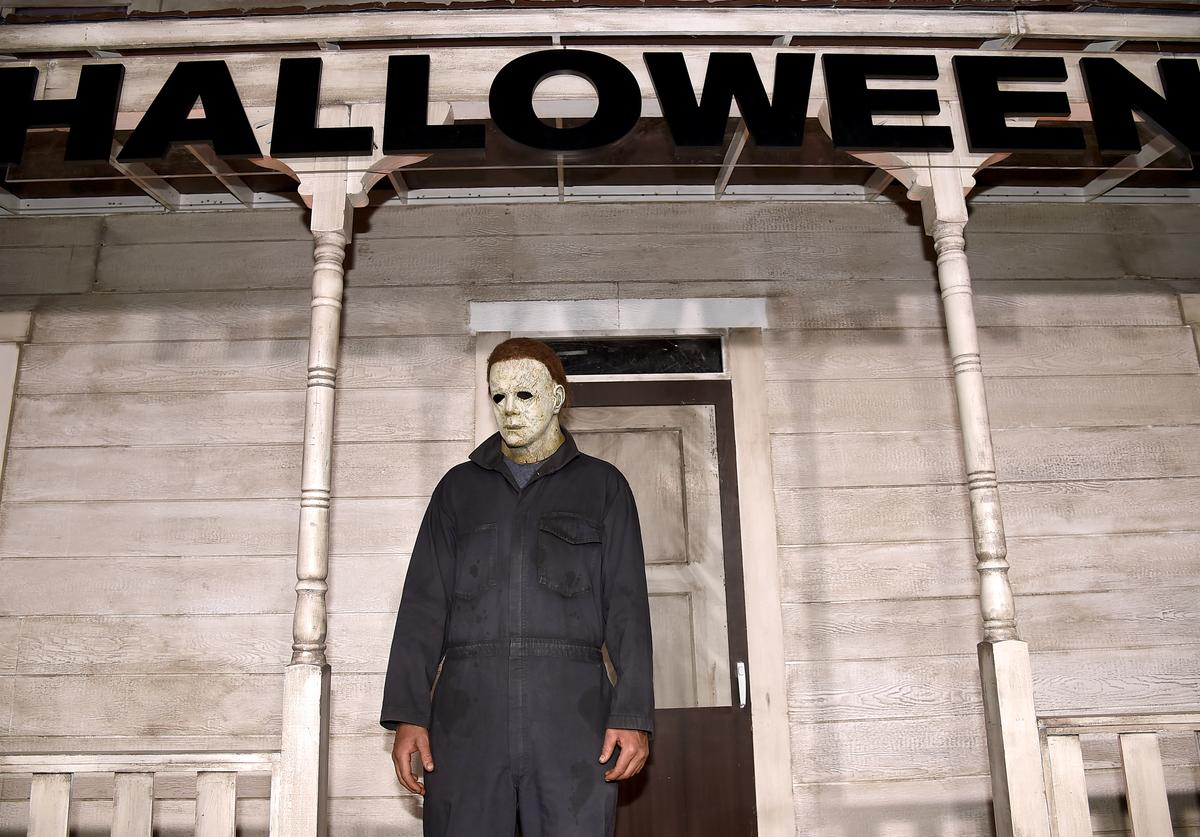 """An actor dressed as the character of Michael Myers attends the Universal Pictures' """"Halloween"""" premiere at TCL Chinese Theatre on October 17, 2018 in Hollywood, California"""