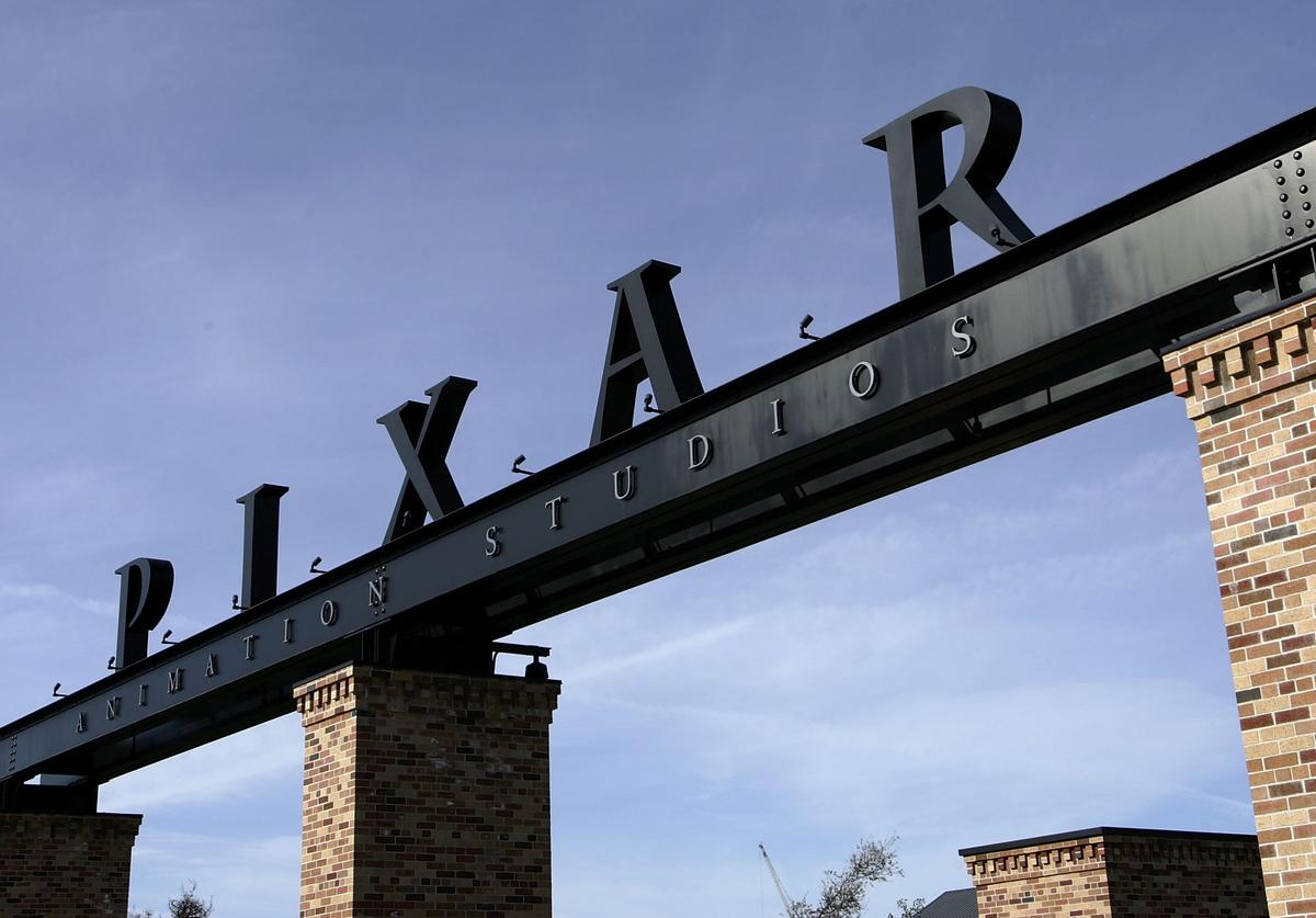 The Pixar logo is seen at the main gate of Pixar Animation Studios January 19, 2006 in Emeryville, California