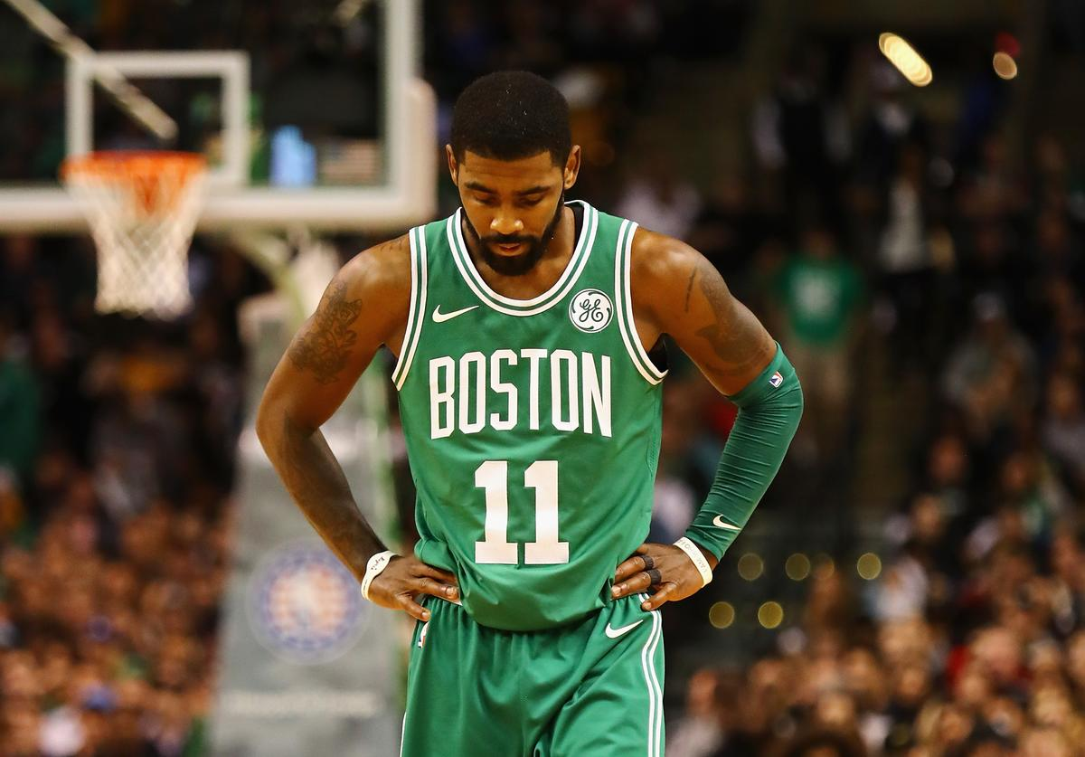 Kyrie Irving #11 of the Boston Celtics reacts during the first quarter against the Los Angeles Lakers at TD Garden on November 8, 2017 in Boston, Massachusetts.