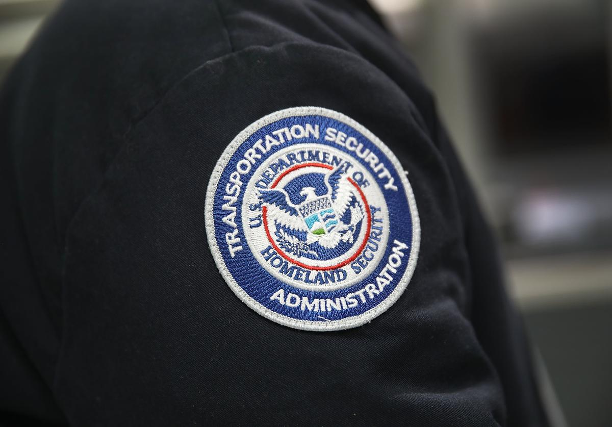 A patch is seen on the jacket of a Transportation Security Administration official as he works at the automated screening lanes funded by American Airlines and installed by the Transportation Security Administration at Miami International Airport on October 24, 2017 in Miami, Florida.