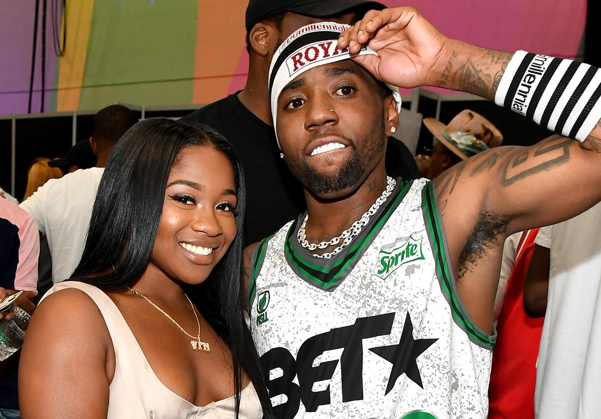 Reginae Carter (L) and YFN Lucci pose at the Celebrity Basketball Game Sponsored By Sprite during the 2018 BET Experience