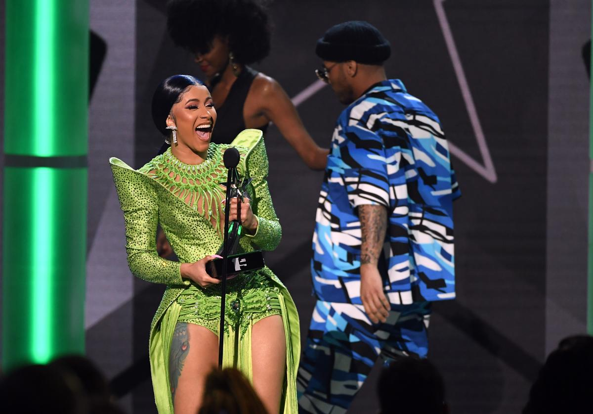 Cardi B (L) accepts Album of the Year from Anderson .Paak onstage at the 2019 BET Awards on June 23, 2019