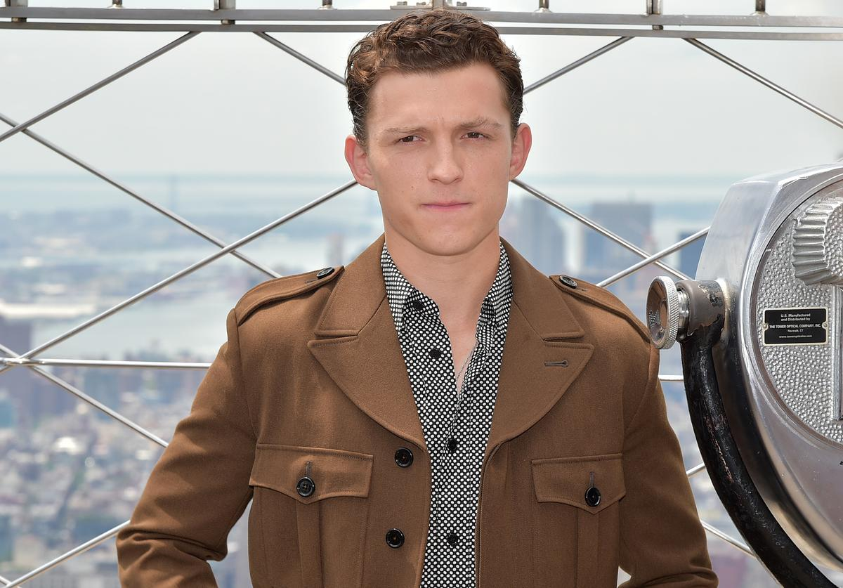 "Tom Holland attends Stars Of ""Spider-Man: Far From Home"" Light The Empire State Building at The Empire State"