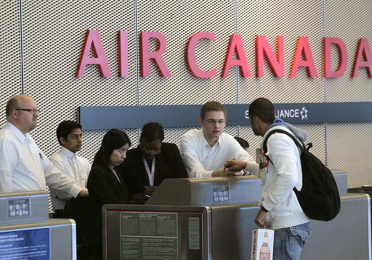A passenger checks in for an Air Canada flight at O'Hare International Airport February 3, 2011