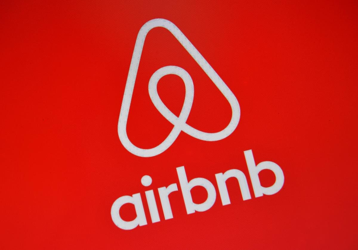 The Airbnb logo is displayed on a computer screen on August 3, 2016 in London, England