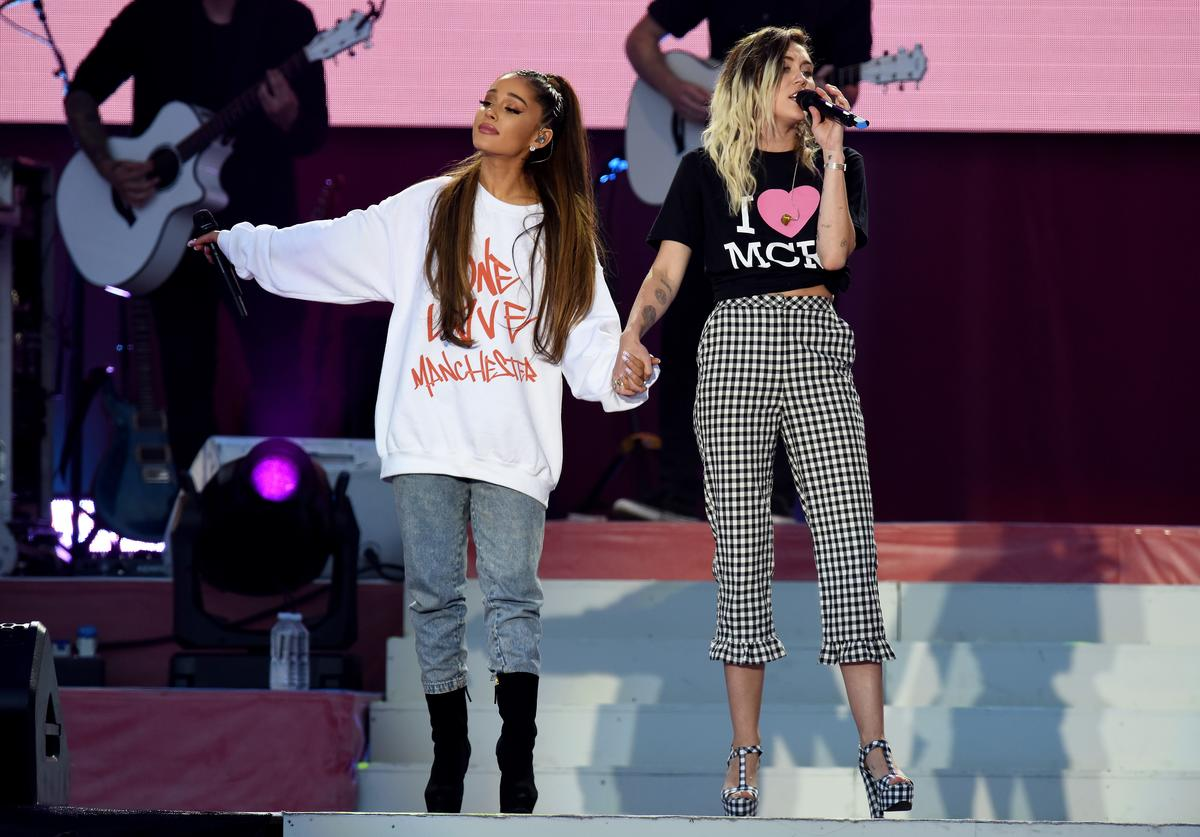 NO SALES, free for editorial use. In this handout provided by 'One Love Manchester' benefit concert (L) Ariana Grande and Miley Cyrus