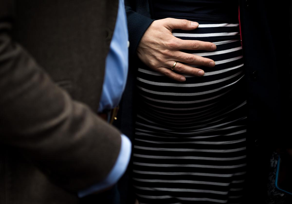 Frauke Petry, head of the Alternative fuer Deutschland (Alternative for Germany, or AfD) right-wing, populist political party, touches his pregnant belly during the AfD election campaign launch event for state elections in North Rhine-Westphalia on April 8, 2017 in Essen, Germany.