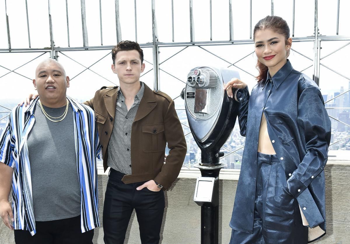 Jacob Batalon, Tom Holland, and Zendaya atend the Spider-Man: Far From Home Cast Light Up The Empire State Building