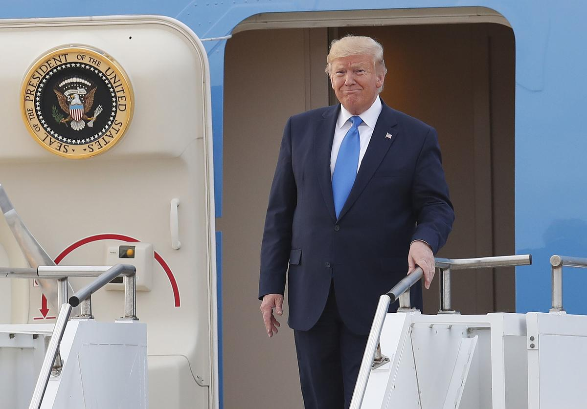 U.S. President Donald Trump disembarks from Air Force One after arriving at Osan Airbase on June 29