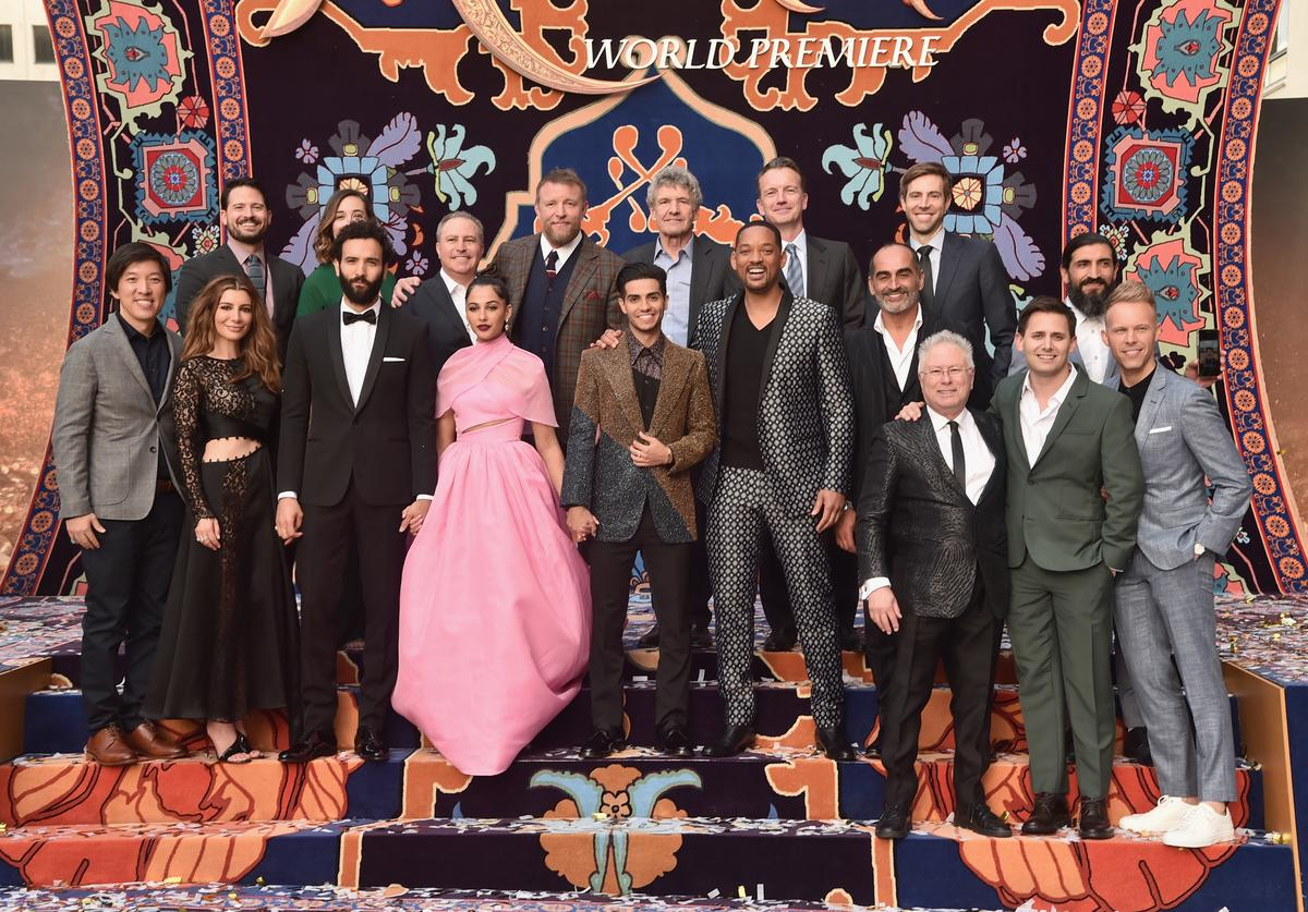 "Producer Dan Lin, actors Nasim Pedrad, Marwan Kenzari, Naomi Scott, Mena Massoud, Will Smith, Navid Negahban, Composer Alan Menken and co-lyricists Benj Pasek and Justin Paul. (L-R back) SVP, Production, The Walt Disney Studios, Louie Provost, Co-Chairman, The Walt Disney Studios, Alan Bergman, Director Guy Ritchie, Co-Chairman and Chief Creative Officer of The Walt Disney Studios Alan Horn, President of Walt Disney Studios Motion Picture Production, Sean Bailey, Producer Jonathan Eirich and actor Numan Acar attend the World Premiere of Disney's ""Aladdin"" at the El Capitan Theater in Hollywood CA on May 21, 2019, in the culmination of the film's Magic Carpet World Tour with stops in Paris, London, Berlin, Tokyo, Mexico City and Amman, Jordan."