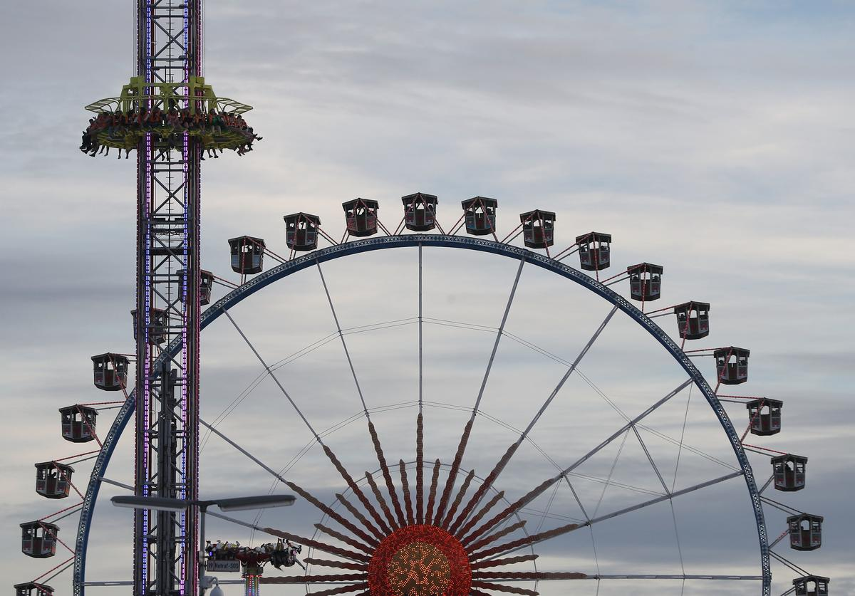 The ferris wheel and a rollercoaster are pictured at the opening day of the 2018 Oktoberfes