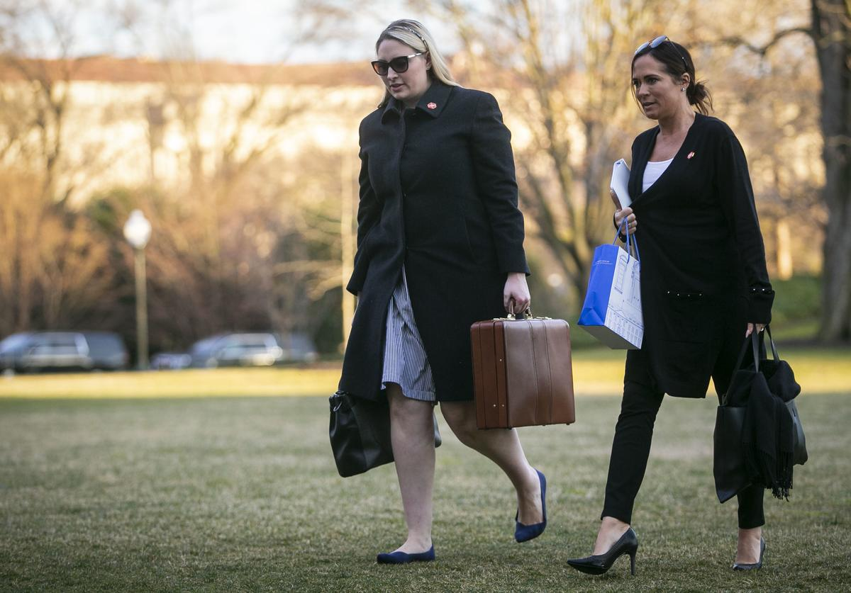 Emma Doyle, White House principal deputy chief of staff, and Stephanie Grisham, communications director for First Lady Melania Trump, arrive on the South Lawn of the White House, on March 10, 2019 in Washington, DC