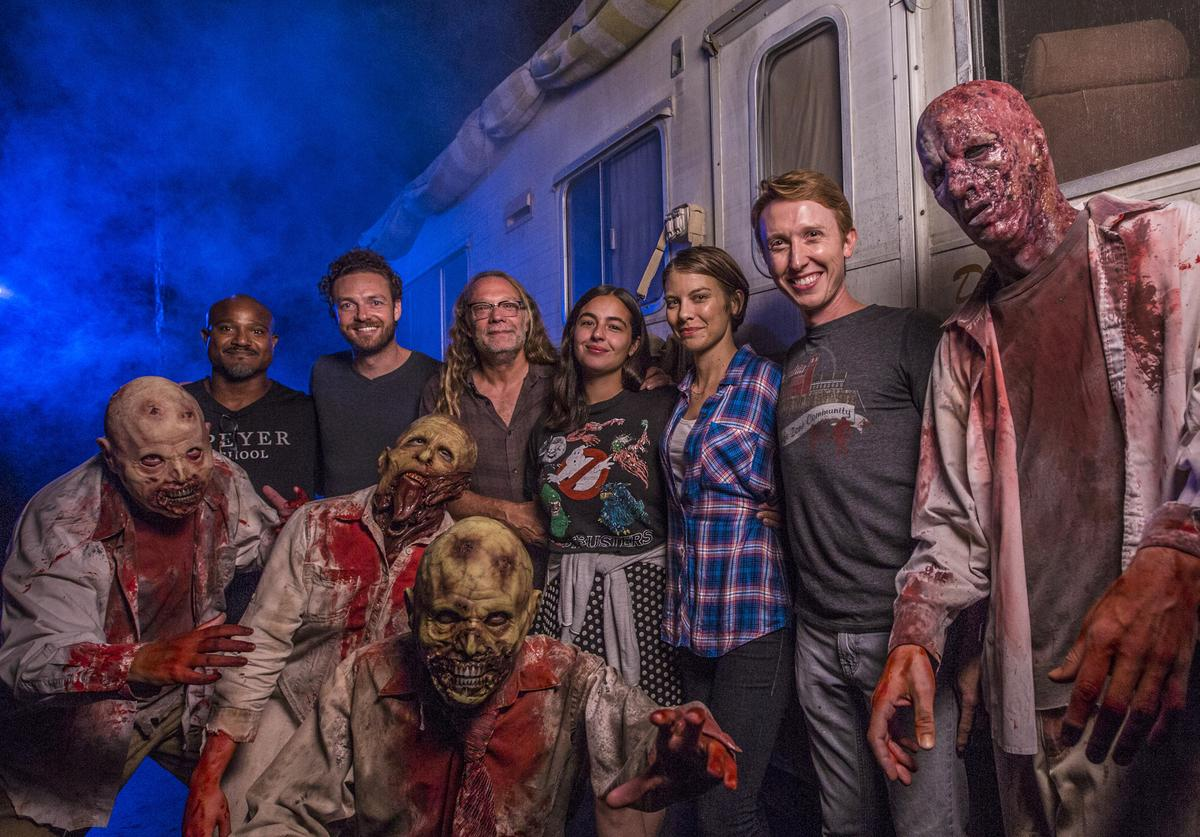 """In this handout photo provided by Universal Orlando, cast members from AMC's """"The Walking Dead"""""""